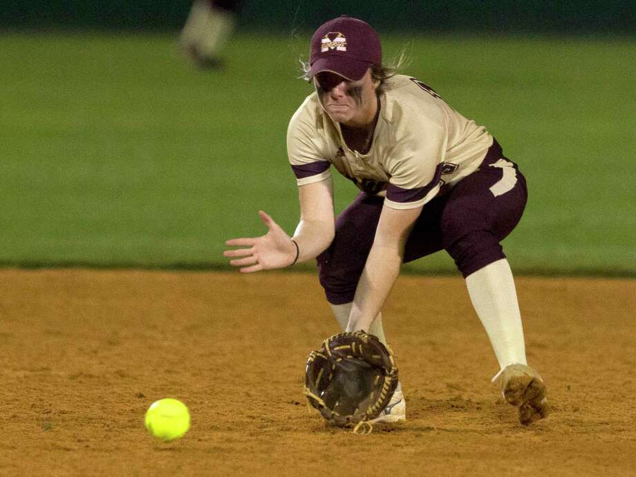 Magnolia West shortstop Emma McBride fields a ground ball by Casey Dixon of Willis during the third inning of a District 20-5A high school softball game Thursday, March 8, 2017, in Willis. Willis defeated Magnolia West 3-0. Photo: Jason Fochtman, Staff Photographer / © 2017 Houston Chronicle