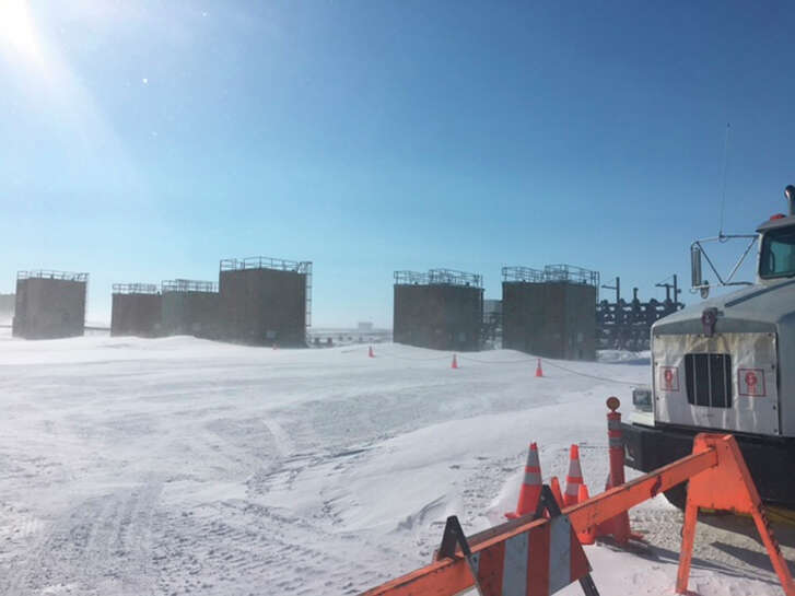 This photo provided by the U.S. Environmental Protection Agency shows an oil well that was misting crude over the weekend on Alaska's North Slope. Crews were able to kill the well.