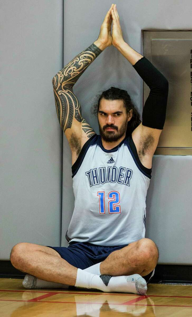 Thunder center Steven Adams takes Monday's post-practice stretching session seriously.