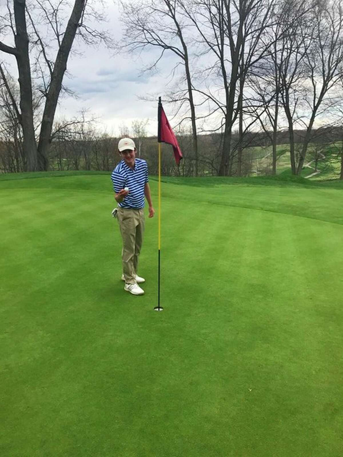 Photo provided Midland High golfer Drew Gandy shows the ball that he hit for a hole in one at Monday's Forest Hills Invitational.