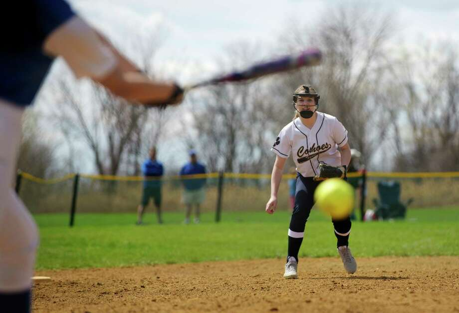 Haleigh Burgess of Cohoes moves in on a batter during the Ichabod Crane and Cohoes girls softball game on Monday, April 17, 2017, in Cohoes, N.Y.  (Paul Buckowski / Times Union) / Cohoes