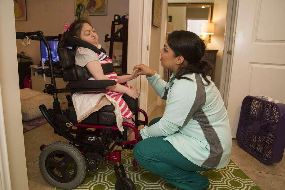Chloe, 10, who was born with a rare chromosome disorder, requires 24-hour care. Photo: Alma E. Hernandez / Alma E. Hernandez / For The San Antonio Express News