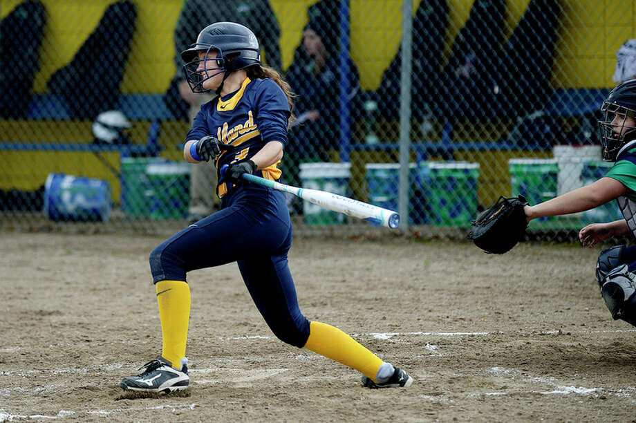 NICK KING | nking@mdn.net  Midland's Julia Gross gets a hit against Heritage during the third inning on Monday at Midland High School. The Chemics won the first game of the double-header 10-0 in five innings. / Midland Daily News