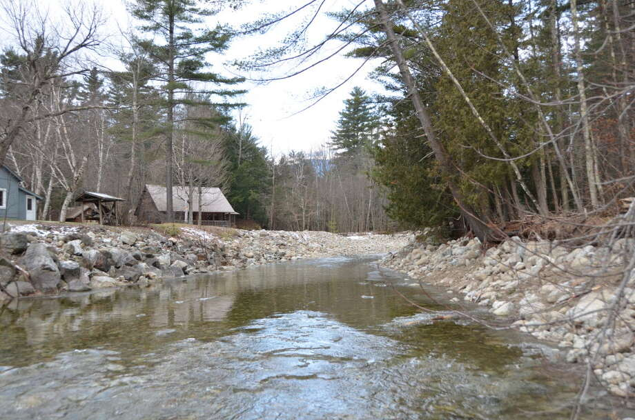 A view of Johns Brook upstream of the Route 73 bridge in Keene shows how's emergency flood control work, done after tropical storms irene and Lee in 2011, gave the stream the look of an engineered drainage ditch.
