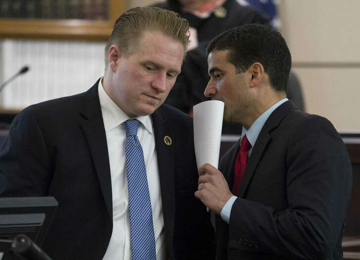 District Attorney Nico LaHood talks with prosecutor Jason Goss at the trial of Miguel Martinez, who was granted a mistrial in the case of Laura Carter, whom Martinez was accused of killing. LaHood later was accused by defense attorneys of trying to destroy their practices.