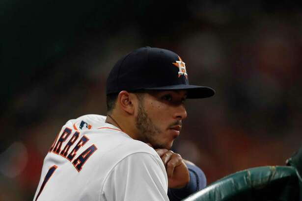 Houston Astros shortstop Carlos Correa (1) in the dugout with a bruised hand during the third inning of an MLB baseball game at Minute Maid Park, 2017, in Houston.