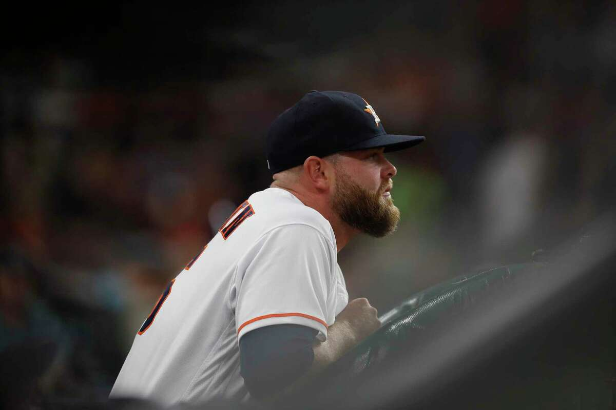 Houston Astros catcher Brian McCann (16) in the dugout during the first inning of an MLB baseball game at Minute Maid Park, 2017, in Houston.