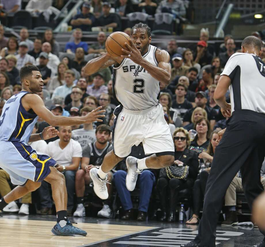 SAN ANTONIO,TX - APRIL 17:  Kawhi Leonard #2 of the San Antonio Spurs tries unsuccessfully to save the ball from going out of bounds against the Memphis Grizzlies in Game Two of the Western Conference Quarterfinals during the 2017 NBA Playoffs at AT&T Center on April 17, 2017 in San Antonio, Texas.  NOTE TO USER: User expressly acknowledges and agrees that , by downloading and or using this photograph, User is consenting to the terms and conditions of the Getty Images License Agreement. (Photo by Ronald Cortes/Getty Images) Photo: Ronald Cortes/Getty Images