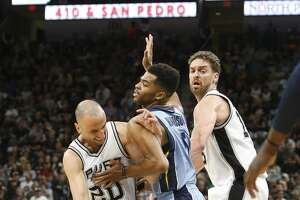 SAN ANTONIO,TX - APRIL 17 :  Manu Ginobili #20 of the San Antonio Spurs fights off Andrew Harrison #5  of the Memphis Grizzlies in Game Two of the Western Conference Quarterfinals during the 2017 NBA Playoffs at AT&T Center on April 17, 2017 in San Antonio, Texas.  NOTE TO USER: User expressly acknowledges and agrees that , by downloading and or using this photograph, User is consenting to the terms and conditions of the Getty Images License Agreement. (Photo by Ronald Cortes/Getty Images)