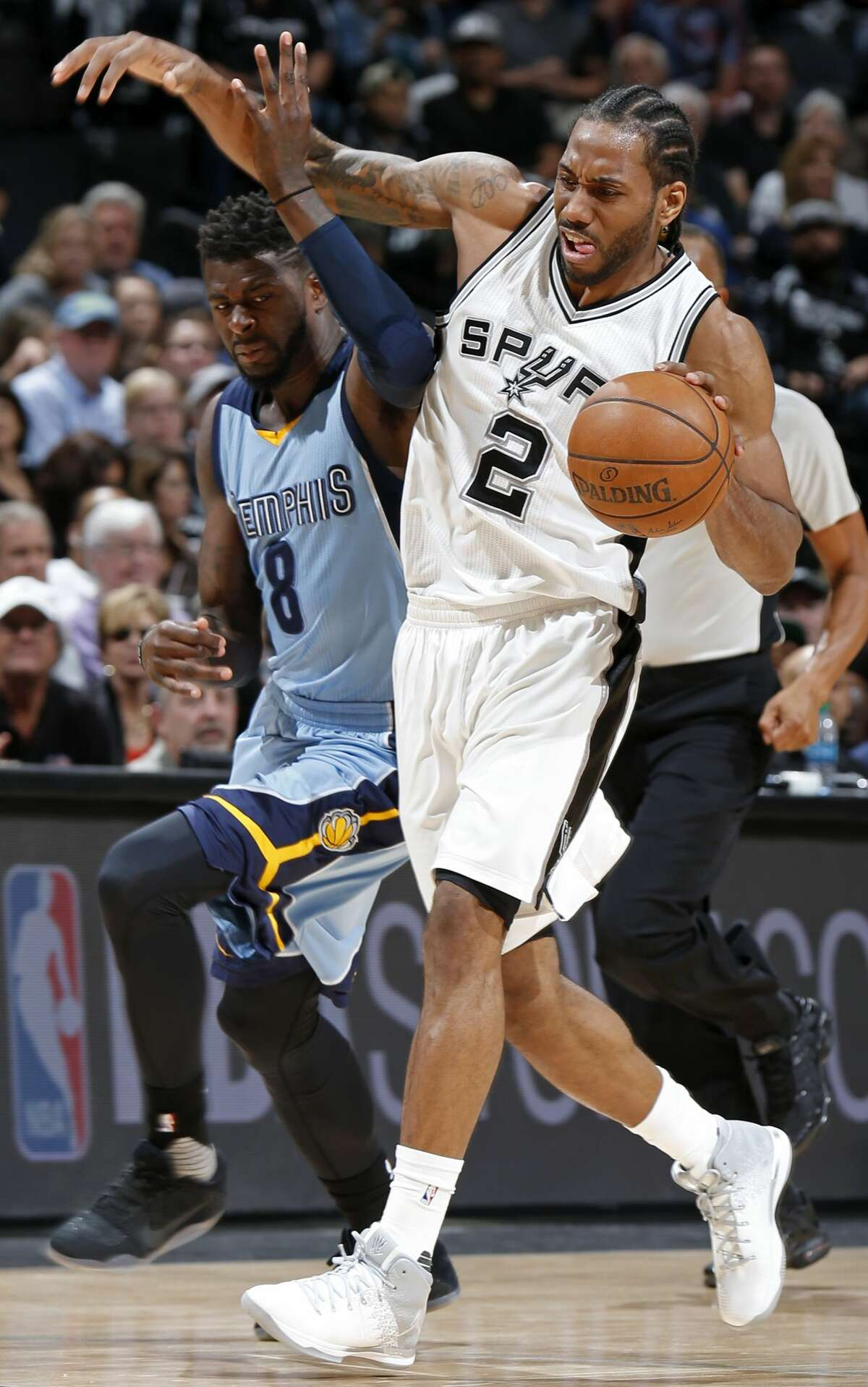 San Antonio Spurs' Kawhi Leonard looks for room around Memphis Grizzlies?• James Ennis III during first half action of Game 2 in the first round of the Western Conference playoffs held Monday April 17, 2017 at the AT&T Center. Leonard was fouled on the play.