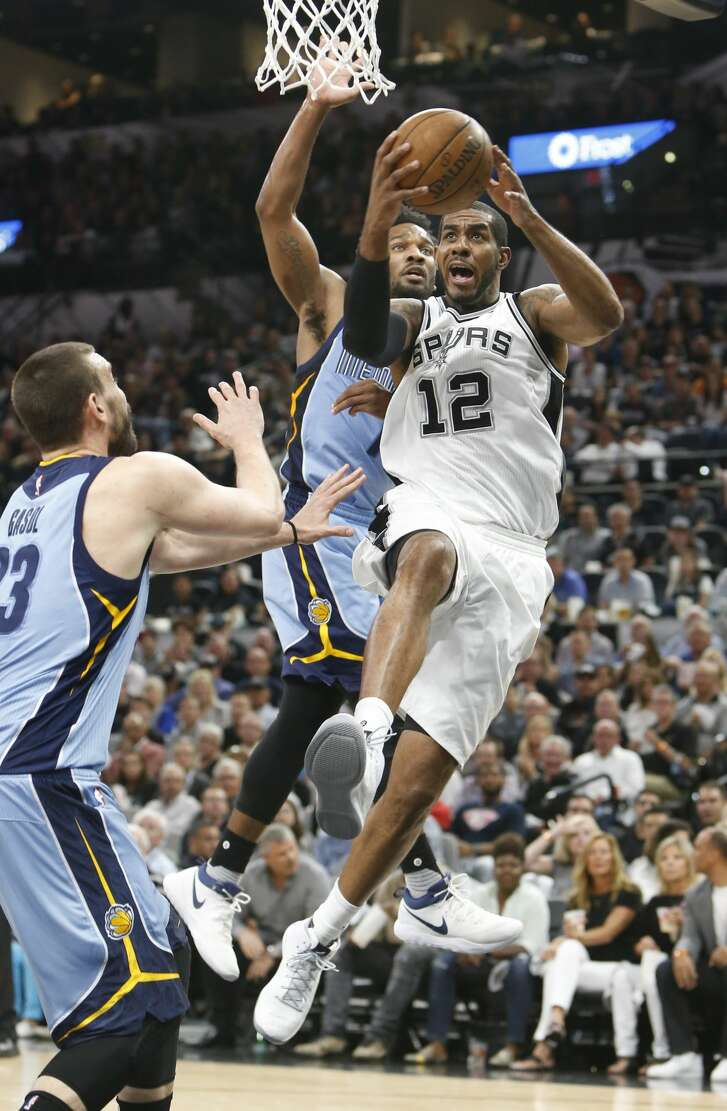 SAN ANTONIO,TX - APRIL 17 :  LaMarcus Aldridge #12 of the San Antonio Spurs goes up for a shot and scores in front of Wayne Selden #7 of the Memphis Grizzlies in Game Two of the Western Conference Quarterfinals during the 2017 NBA Playoffs at AT&T Center on April 17, 2017 in San Antonio, Texas.  NOTE TO USER: User expressly acknowledges and agrees that , by downloading and or using this photograph, User is consenting to the terms and conditions of the Getty Images License Agreement. (Photo by Ronald Cortes/Getty Images)