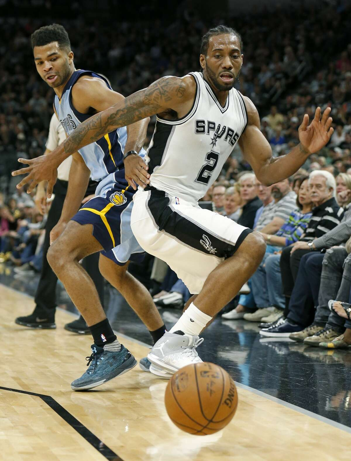 Memphis Grizzlies?• Andrew Harrison and San Antonio Spurs' Kawhi Leonard chase after a loose ball during first half action of Game 2 in the first round of the Western Conference playoffs held Monday April 17, 2017 at the AT&T Center.