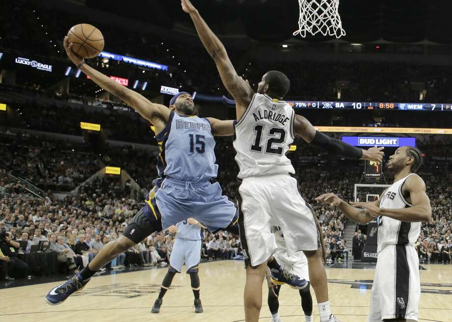 Memphis Grizzlies guard Vince Carter (15) tries to score past San Antonio Spurs forward LaMarcus Aldridge (12) during the first half in Game 2 of a first-round NBA basketball playoff series, Monday, April 17, 2017, in San Antonio. (AP Photo/Eric Gay) Photo: Eric Gay/Associated Press