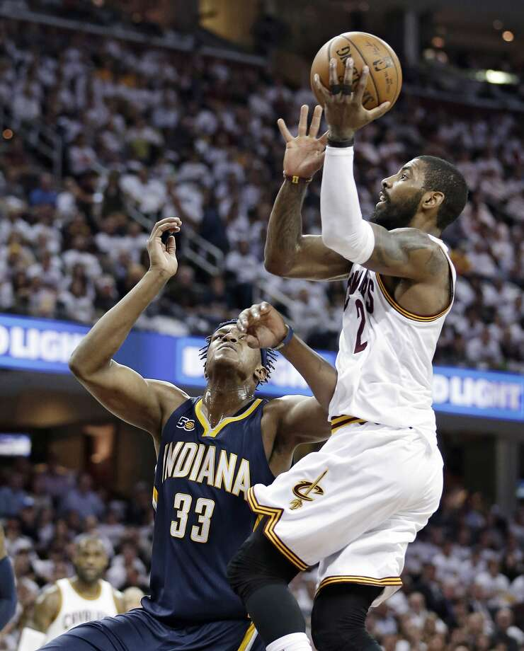 Cavaliers guard Kyrie Irving drives to the basket against the Pacers' Myles Turner in the first half. Irving scored 37 points Photo: Tony Dejak, Associated Press