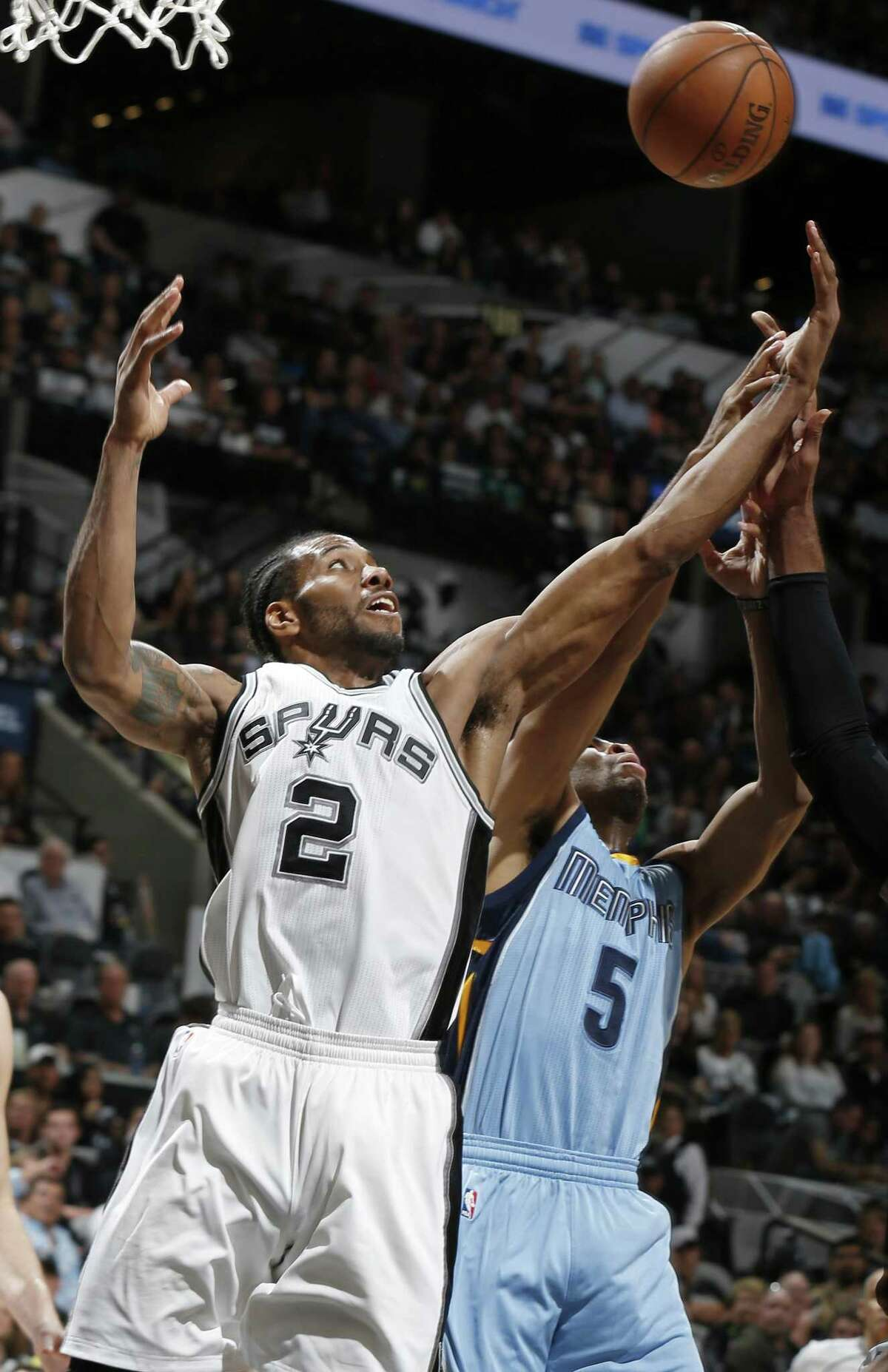 San Antonio Spurs' Kawhi Leonard grabs for a rebound against Memphis Grizzlies?• Andrew Harrison during second half action of Game 2 in the first round of the Western Conference playoffs held Monday April 17, 2017 at the AT&T Center.