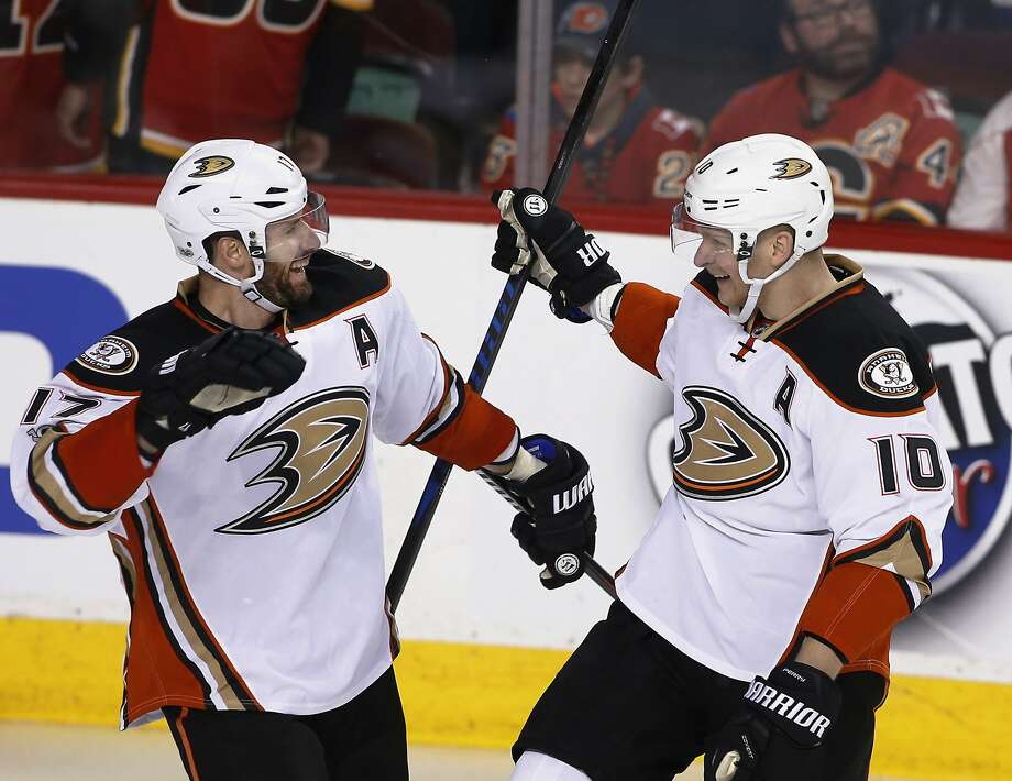 Corey Perry (10) celebrates with Ryan Kesler after scoring in overtime to give Anaheim a 3-0 series lead on Calgary. Photo: Larry MacDougal, Associated Press