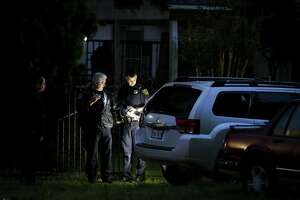 Houston Police officers investigate the scene where a man was shot by a neighbor with a shotgun on the 6000 block of Shotwell Street Tuesday, April 18, 2017, in Houston.