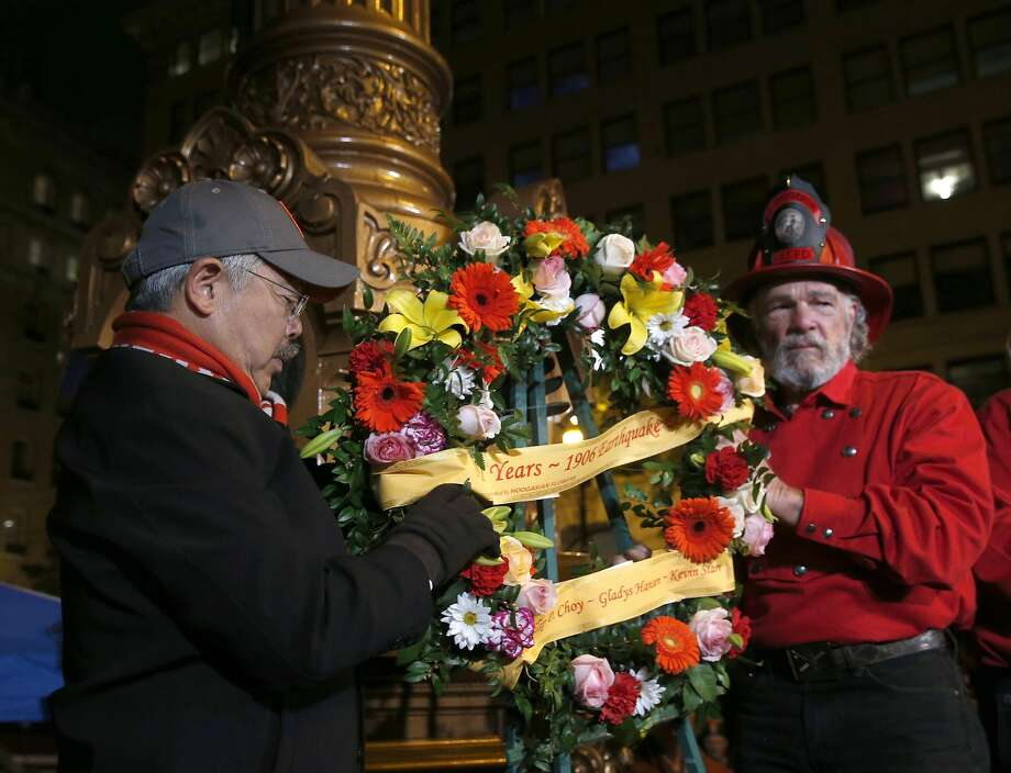 Mayor Ed Lee and John Jamieson place a memorial wreath on Lotta's Fountain to commemorate the 111th anniversary of the 1906 earthquake in San Francisco, Calif. on Tuesday, April 18, 2017. Photo: Paul Chinn, The Chronicle