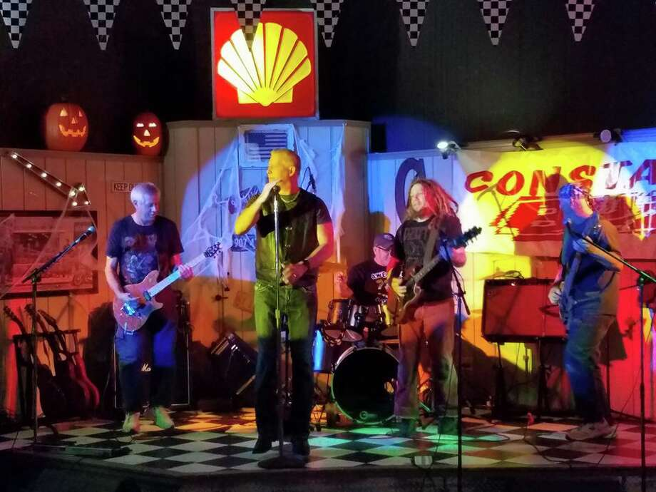 The classic rock/alternative rock band Constant Buzz includes League City resident Mark Turvey, left, a firefighter for Lubrizol, and other firefighters.