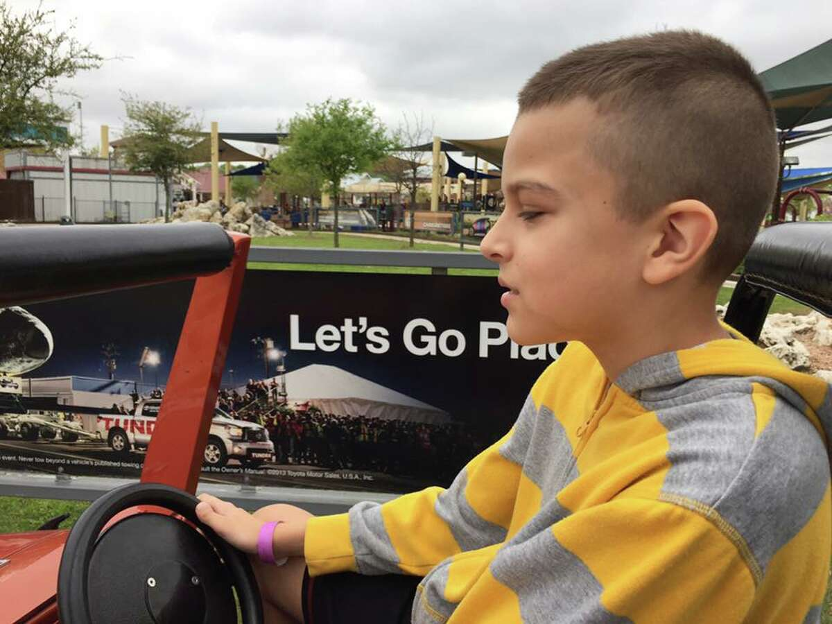 """Paul takes the wheel on the """"Off Road Adventure Ride"""" at Morgan's Wonderland in San Antonio, an amusement park designed specifically for children and adults with disabilities."""