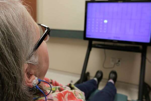 Brenda Kirk has a session with Stephanie Gabel Zepeda, PhD, LMFT, as she participates in an MD Anderson experimental treatment for a type of brain training, known as neurofeedback, that holds promise for reducing symptoms of chemotherapy-induced nerve damage, or neuropathy on Monday, March 6, 2017, in Houston. ( Elizabeth Conley / Houston Chronicle )