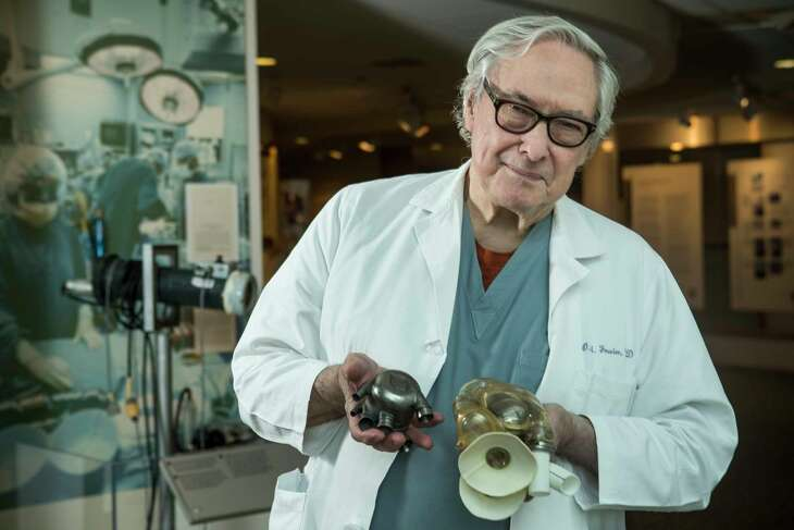 Dr. Bud Frazier poses for a portrait at the Texas Heart Institue on Monday, March 6, 2017, in Houston. Frazier holds a BiVACOR total Artificial Heart, that is in development, on the left; and an AbioCor implantable replacement heart from 2001. ( Brett Coomer / Houston Chronicle )