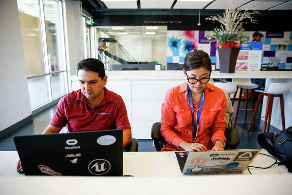 OnComfort programmer Eduardo Garza, left, and cofounder Joowon Kim work on their virtual reality experience app designed to help cancer patients manage their pain and anxiety Wednesday, Nov. 30, 2016 in Houston. The VR games range from a meditating journey through the ocean to flying through the body zapping cancer cells. ( Michael Ciaglo / Houston Chronicle )