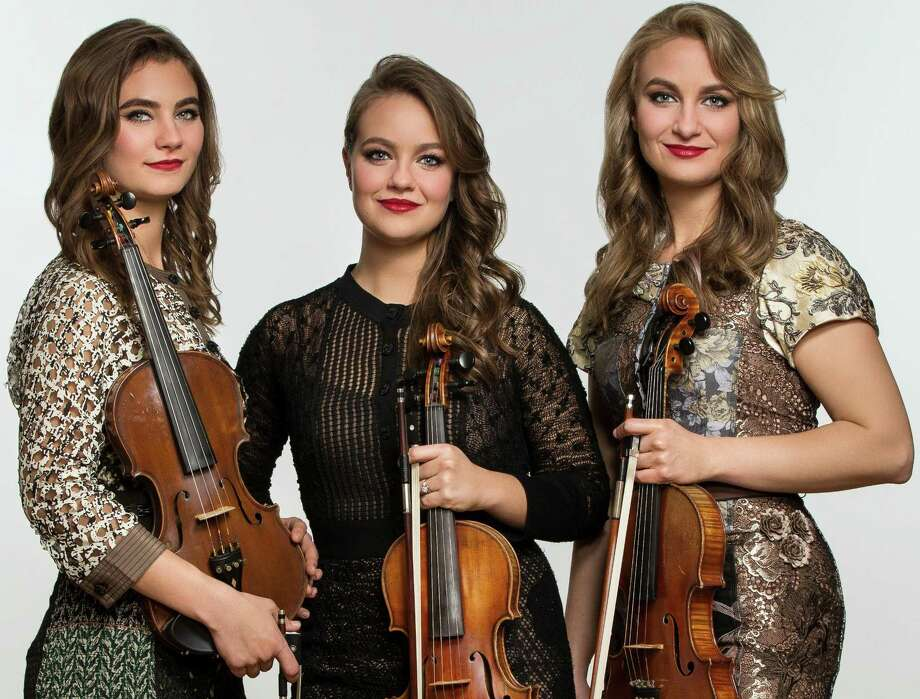 The fiddle-playing, Texas born and bred Quebe Sisters are Grace (from left), Hulda and Sophia Quebe. Photo: Courtesy Photo / Stewart Cohen Pictures