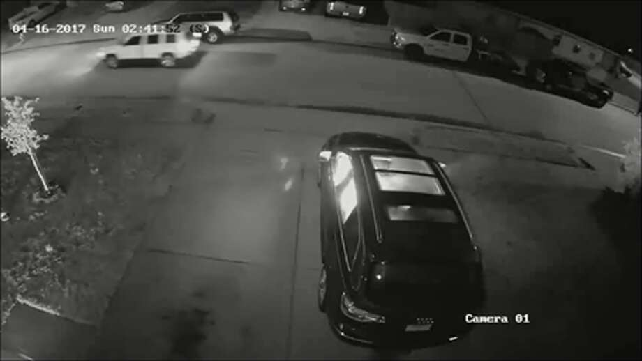 A screenshot of surveillance footage of a home in the 2300 block of Kolby Way in Spring, Texas on April 16, 2017. Investigators say a trio of arsonists firebombed the house and SUV and fled in a dark-colored vehicle and a white SUV. Photo: Harris County Fire Marshal's Office/Houston Chronicle