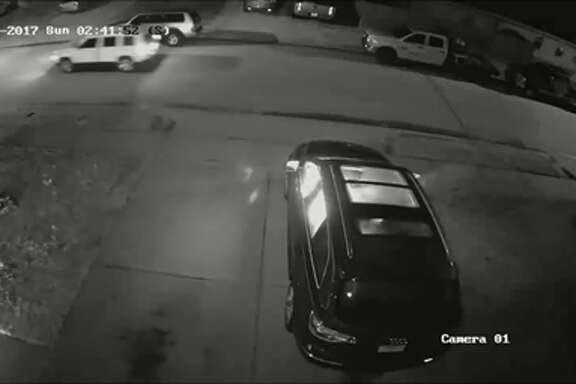 A screenshot of surveillance footage of a home in the 2300 block of Kolby Way in Spring, Texas on April 16, 2017. Investigators say a trio of arsonists firebombed the house and SUV and fled in a dark-colored vehicle and a white SUV.