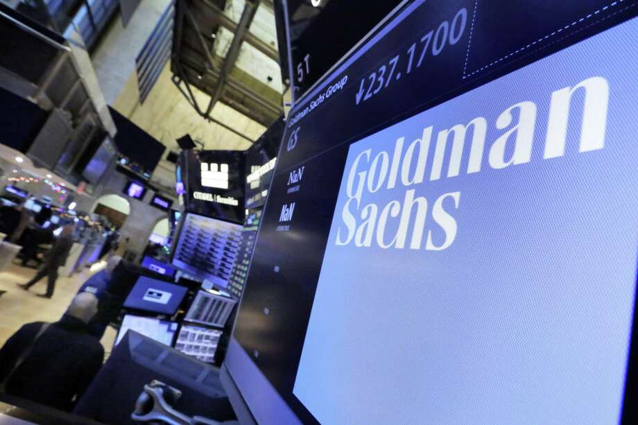 Goldman Sachs earned $2.16 billion compared with $1.2 billion in the same period a year earlier. On a per-share basis, it earned $5.15 a share versus $2.68 a share in the same period a year earlier. But Goldman's results were well below the $5.31 a share expected by analysts, according to FactSet. Photo: Richard Drew /Associated Press / AP