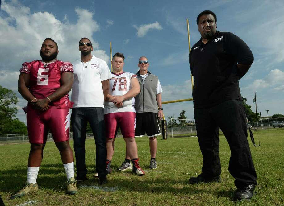 Wilford Scypion Jr., right, owner of the Golden Triangle Seminoles stands with, from left, Joe Lee, Russell Dycus, Justin Rideau, and Vidor football Coach Jeff Mathews, at the Vidor Junior High on Thursday.   Photo taken Thursday, April 13, 2017 Guiseppe Barranco/The Enterprise Photo: Guiseppe Barranco, Guiseppe Barranco/The Enterprise