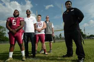 Wilford Scypion Jr., right, owner of the Golden Triangle Seminoles stands with, from left, Joe Lee, Russell Dycus, Justin Rideau, and Vidor football Coach Jeff Mathews, at the Vidor Middle School on Thursday.   Photo taken Thursday, April 13, 2017 Guiseppe Barranco/The Enterprise