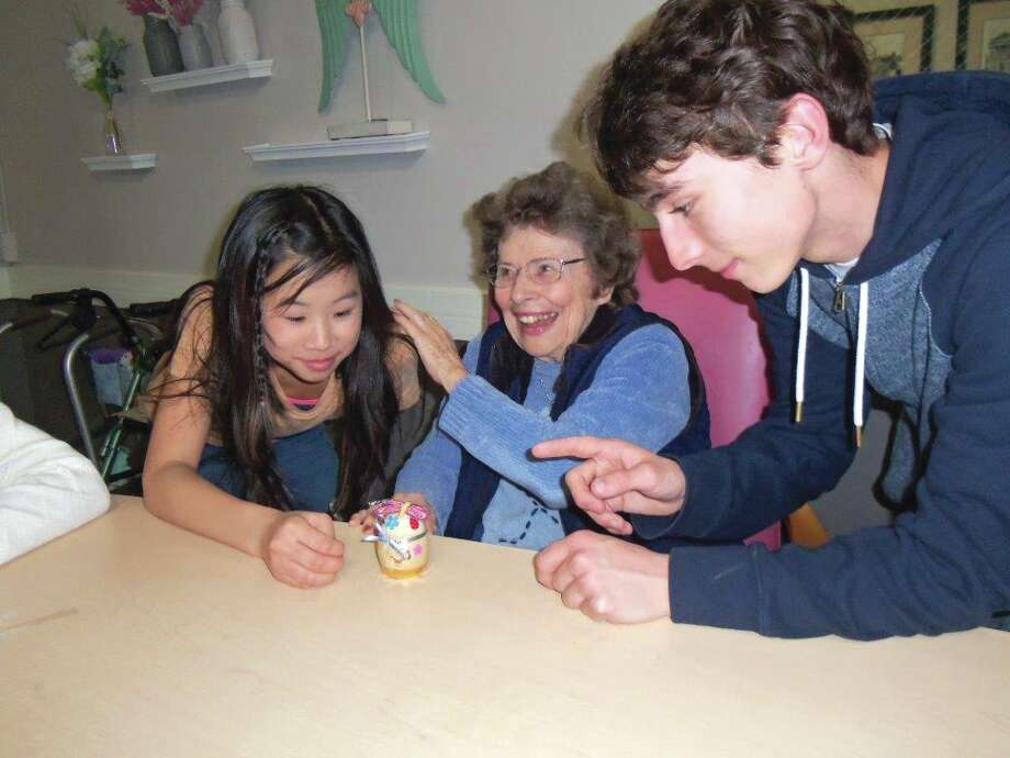 As part of an ongoing intergenerational activity program, the King's Kids Home School joined Eden Village residents in creating decorated wooden Easter eggs. There were smiles all around as students and residents celebrated the arrival of Spring. From left are: Mollie Lybarger, resident Nina Baird, and Noah Hubler. Photo: For The Intelligencer