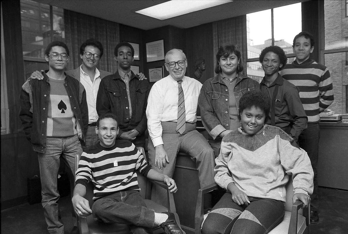 FILE � Eugene Lang with the graduates of Public School 121 in New York, Oct. 18, 1985. Lang, an investor whose impulsive promise to the East Harlem sixth-grade class that he would pay for their college education inspired a foundation, led to the support of more than 16,000 children nationwide and made him something of an American folk hero, died April 8, 2017, at the age of 98. (Chester Higgins Jr./The New York Times)