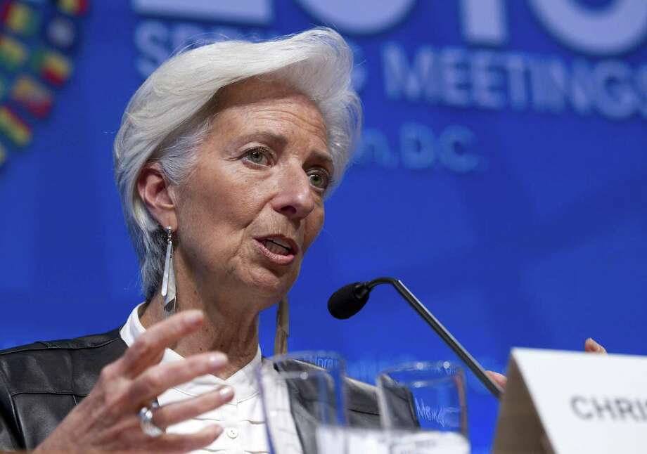 A resilient China, rising commodity prices and sturdy financial markets are offering a sunnier outlook for the global economy and helping dispel the gloom that has lingered since the Great Recession ended, according to IMF, which predicts that the world economy will grow 3.5 percent in 2017, up from 3.1 percent in 2016. Shown is the IMF's managing director, Christine Lagarde. Photo: Associated Press File Photo / FR159526 AP