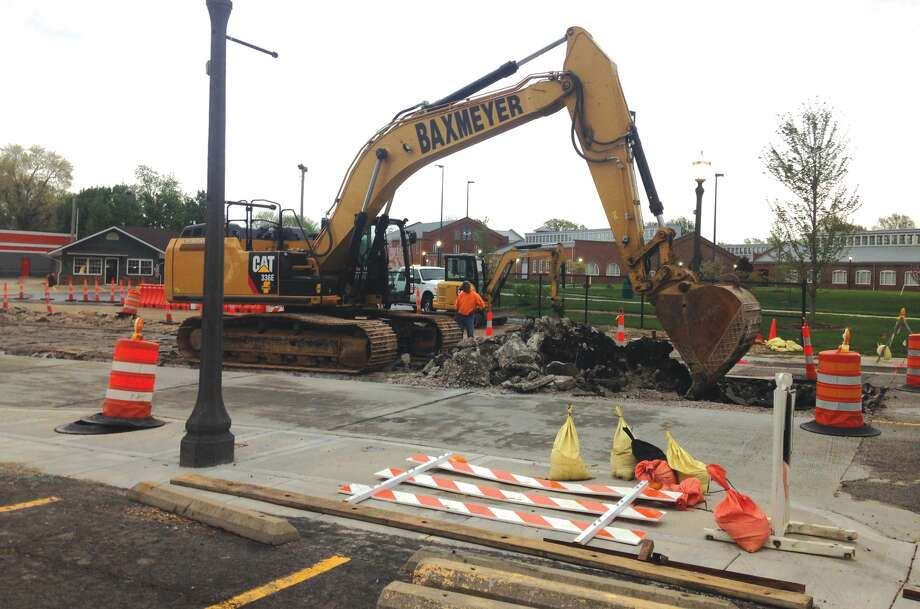 Crews were out before 7 a.m. Monday, removing the center lane of South Buchanan Street. The reconstruction project has closed the roadway from the MCT bus station across from Leclaire Ball Field to Schwarz Street. The project is expected to continue for the next 19 days. Alternate routes have been posted. Photo: Bill Tucker • Intelligencer