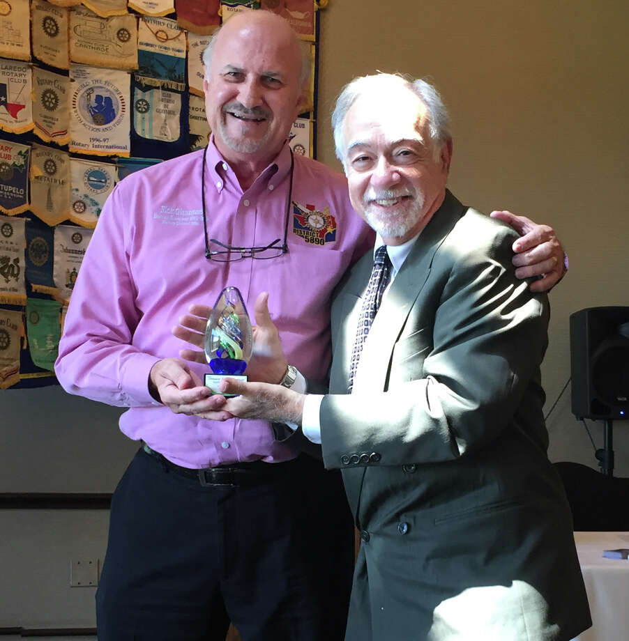 Rotary District Gov. Nick Giannone honors Katy Rotary Club member David Frishman with the Rotary International Service and Dedication Award. Photo: Katy Rotary Club