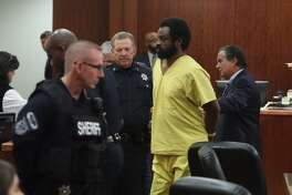 Shannon Miles leaves the courtroom after his trial was moved to later this year.