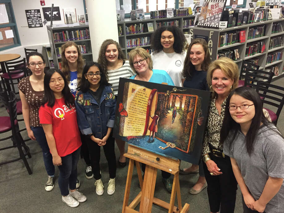 "Cinco Ranch High School art teacher Cindy Reilly (center) and Firethorne Marketing Director Janet Burkett (second from right) recently met with art students who created the 2017 KEYS Mentor Program mixed-media painting, ""The Next Chapter,"" to congratulate them on their artwork. The students are, from left, front row: Angela Young, Arfa Khan, (Reilly), Libby Perego, (Burkett) and Alice Yang; back row: Meghan Hunt, Rachel Lore, Kelly Salinas and Josephine Schider. Photo: Firethorne"