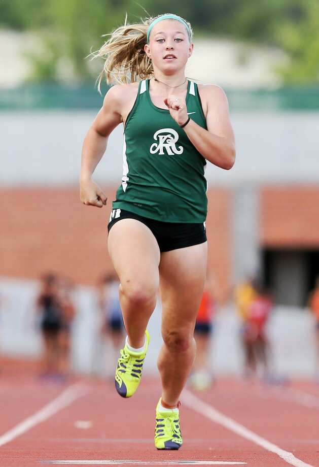 Reagan's Taylor Olson approaches the finish line in the in the 100-meter dash during the North East Relays at Heroes Stadium on April 6, 2017. Photo: Marvin Pfeiffer /San Antonio Express-News / Express-News 2017