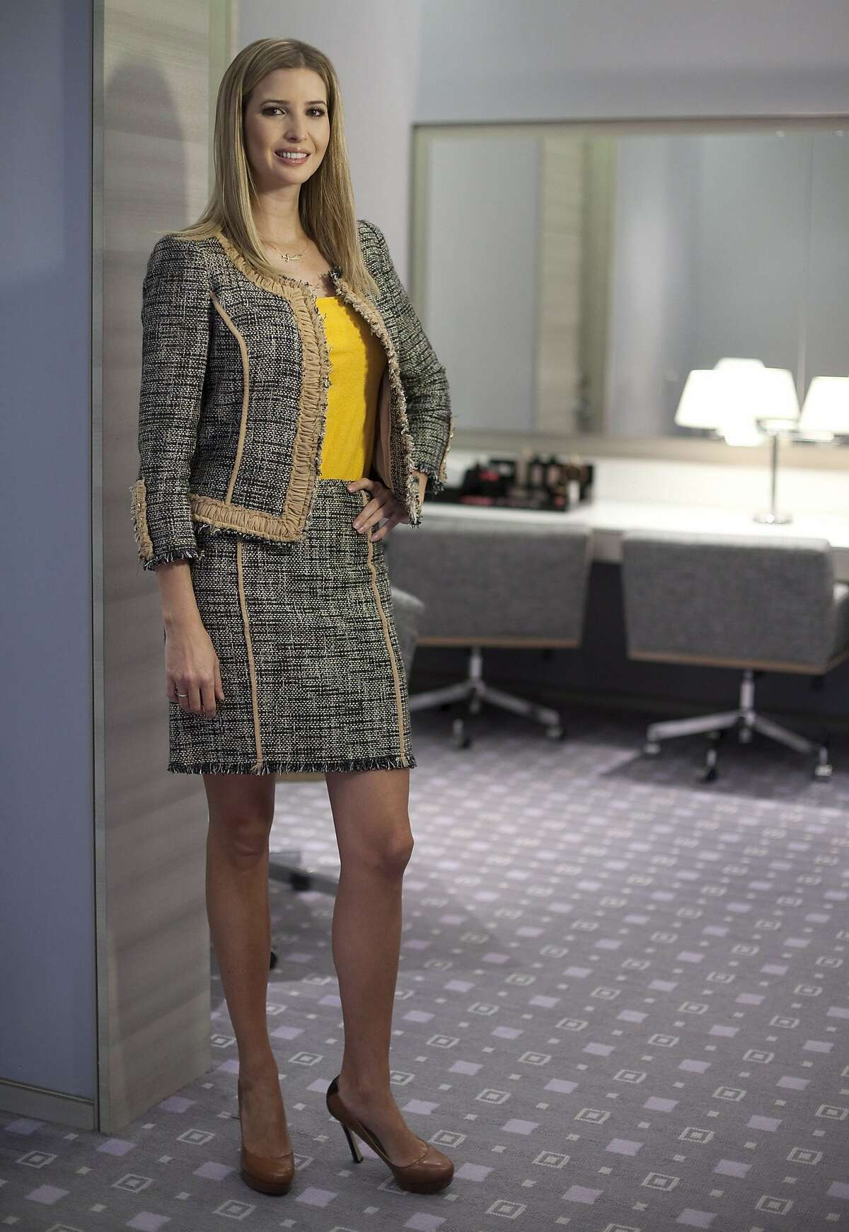 In this March 6, 2015, file photo, Ivanka Trump models an outfit following an interview to promote her clothing line in Toronto. Trump just announced that she'll be shuttering her namesake fashion brand following sluggish sales and a concerted consumer boycott.