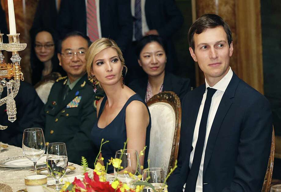 Ivanka Trump is seated with her husband, White House senior adviser Jared Kushner, during a dinner with President Donald Trump and Chinese President Xi Jinping at Mar-a-Lago in Palm Beach, Fla. Earlier in the day, Ivanka Trump's company received provisional approval from the Chinese government for three new trademarks, winning monopoly rights to sell Ivanka brand jewelry, bags and spa services in the world's second-largest economy. Photo: Alex Brandon /Associated Press / Copyright 2017 The Associated Press. All rights reserved.