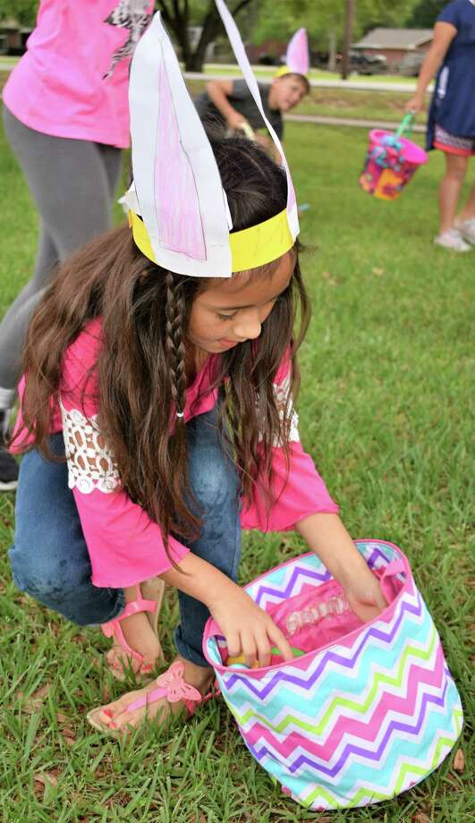 Emma Talamantez, a first-grader in Janie Smerek's class at Needville Elementary, hunts Easter eggs Thursday morning on the playground. Photo: Needville