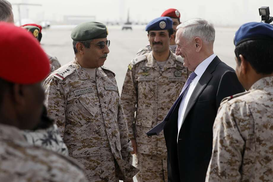 James Mattis is greeted by Armed Forces Chief of Joint Staff Gen. Abdul Rahman Al Banyan (left). Photo: Jonathan Ernst, Associated Press