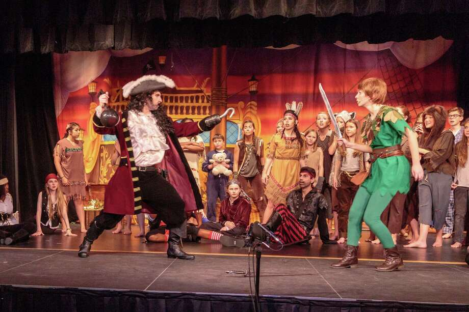 "Fort Bend Christian Academy Performing Arts Department performed three shows of ""Peter Pan Jr"" in early April. Senior Ethan Walker played the villain, Captain Hook, and junior Hayden Roberts starred as Peter Pan. Photo: Fort Bend Christian Academy / 2016 Sarah Fiore"