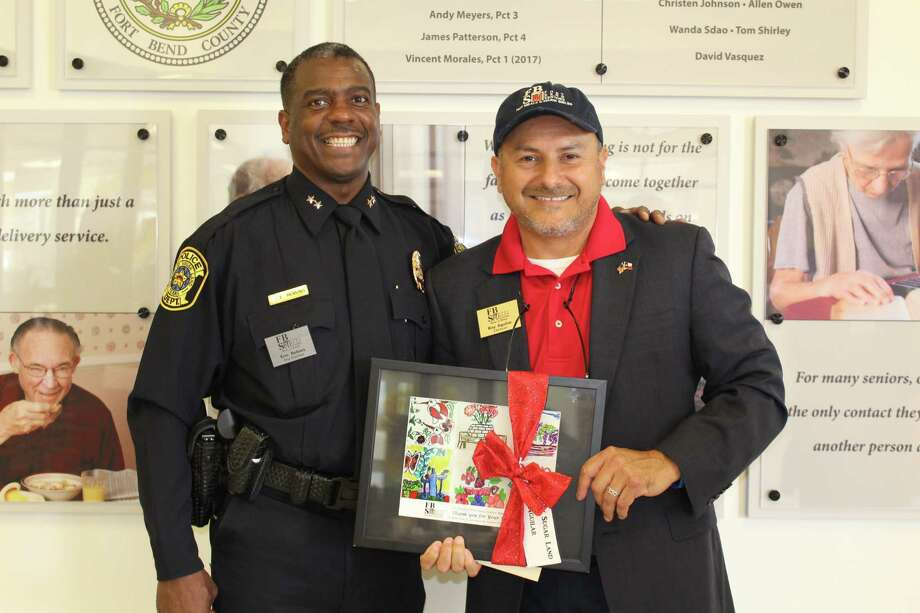Eric Robins, City of Sugar Land PD; Ray Aguilar, Classic Chevy Sugar Land attended the ribbon cutting for Fort Bend Seniors Meals on Wheels. Photo: Central Fort Bend Chamber