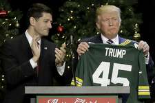 FILE - In this Dec. 13, 2016, file photo, President-elect Donald Trump holds up Green Bay Packers jersey given to him by House Speaker Paul Ryan at a rally in West Allis, Wis. President Donald Trump heads to Ryan's congressional district in Wisconsin on Tuesday, April 18, 2017, facing low approval ratings and in the wake of his failure to fulfill a campaign promise to repeal and replace the federal health care law. (AP Photo/Morry Gash, File)