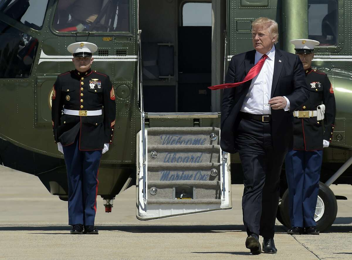 President Donald Trump walks towards Air Force One at Andrews Air Force Base in Md., Tuesday, April 18, 2017. Trump is heading to Kenosha, Wis., to visit the headquarters of tool manufacturer Snap-on Inc., and sign a an executive order that seeks to make changes to a visa program that brings in high-skilled workers. (AP Photo/Susan Walsh)