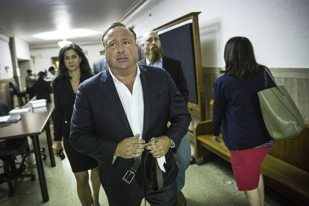 """In this Monday, April 17, 2017 photo, """"Infowars"""" host Alex Jones arrives at the Travis County Courthouse in Austin, Texas."""